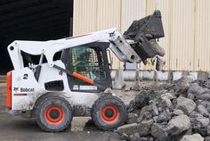 A Bobcat S770 sorts things out with a combination bucket attachment. The S770 has an operating load of 3,350 pounds, or 3,550 with the optional counterweight.    Full specs:  http://www.specguideonline.com/product/bobcat-s770    #construction #equipment #loader #skidsteer #bobcat