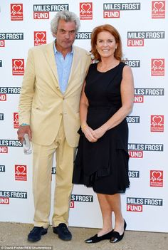 The Duchess of York posed for pictures at the Miles Frost Fund party with a mystery guest
