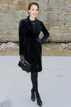 Jessica Alba arrived for the Christian Dior Haute Couture spring/summer 2013 show wearing a black fur coat with patent boots and carried a clutch.