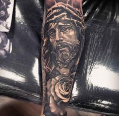 Jesus with a flower and crown of thorns Tattoo - Ideas Tattoo Designs Jesus Tattoo Sleeve, Arm Sleeve Tattoos, Forearm Tattoo Men, Leg Tattoos, Black Tattoos, Body Art Tattoos, Cool Tattoos, Tatoos, Future Tattoos
