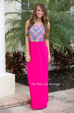 You'll be dreaming of wearing this gorgeous maxi all day long! Featuring a vibrant multicolor top with neon pink, orange, yellow, green, light blue, purple, black, and white, the bold colors are so perfect for summer! It also has a scoopneck, tank bodice, and a soft skirt in a bright shade of pink.