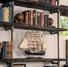 Learn how to build this impressive industrial pipe shelving the easy way! We've sourced the cheapest supplies if you're on a budget. These DIY pipe shelves are perfect for farmhouse, rustic, or industrial modern decor. Diy On A Budget, Industrial Shelving, Industrial Shelf Diy, Shelves, Modern Industrial Decor, Industrial, Bookshelves Diy, Home Design Diy, Industrial Home Design