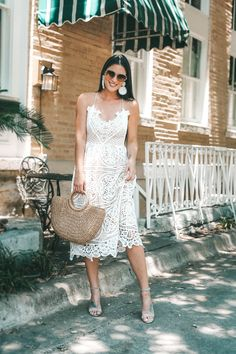White Lace Dress for Summer | Beautiful lace up back detail with Baublebar statement earrings. - The Most Versatile White Lace Dress for Summer featured by popular Austin fashion blogger Dressed to Kill #fashion #style #whitedress #dresses #womensoutfit #womensfashion #outfits #white #summerfashion #dtkaustin