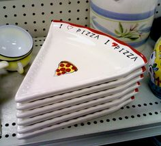 A set of six ceramic pizza-slice plates. GUESS WHO I THOUGHT OF?!? (NOT taken with that goddamn fucking Instagram.)