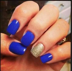 One glittery gold nail with royal blue