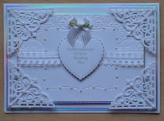 A wedding card made using spellbinder dies and a darice embossing folder, played safe and went for white and silver.