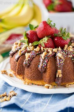 This Banana Split Bundt Cake is packed with summer flavors! Banana Cake with strawberries and walnuts, topped with rich chocolate glaze, sweet strawberries and even more crunchy walnuts! Plus, SPRINKLES! Because who doesn't love sprinkles? Strawberry Desserts, Köstliche Desserts, Delicious Desserts, Bunt Cakes, Cupcake Cakes, Cupcakes, Mothers Day Desserts, Cake Recipes, Dessert Recipes