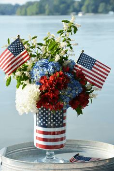 Celebrate the Red, White and Blue with a DIY Patriotic Flower Arrangement using an American Flag. You'll also find a recipe for Red, White and Blue Sangria for your Star-Spangled Celebration. Fourth Of July Decor, 4th Of July Celebration, 4th Of July Decorations, 4th Of July Party, July 4th, Americana Decorations, Memorial Day Decorations, Patriotic Crafts, Patriotic Party