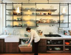 small kitchen with open shelving/frosted glass doors