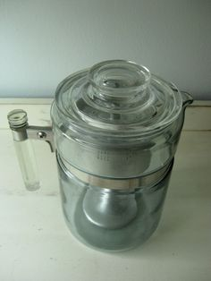 Vintage Pre-World War II 1938 6 Cup Clear Glass Pyrex Flameware Percolator with Metal Inserts. $35.00, via Etsy.