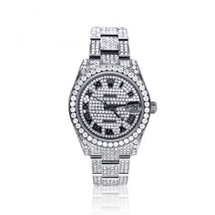 Iced Out Watches: This Pre-Owned Ladies Diamond Rolex Datejust Watch is an old time classic now decorated with custom set 12 carats of diamonds on the stainless steel case, bracelet and even face.
