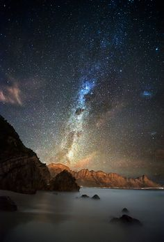 The Milky Way Galaxy rises over Kogel Bay, South Africa.