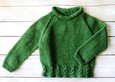 This sweater will fit toddler boys up to 2 years old.  Hand knitted from 100% wool, this classic roll-neck pullover is a soft forest green, and has cable detailing at the hem. Perfect gift to keep your favorite baby boy warm through the winter.  Sweater measures 14 high, 13 across chest, and 14 from neckline to cuff.  Hand washable.