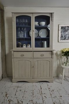 This shabby chic antique Victorian kitchen dresser has been painted in Farrow & Ball Purbeck Stone with Valspar Blue Embrace in the top cupboard. We love its rustic original style - perfect for storing all your kitchen essentials! http://www.thetreasuretrove.co.uk/kitchen-storage/grey-antique-kitchen-dresser