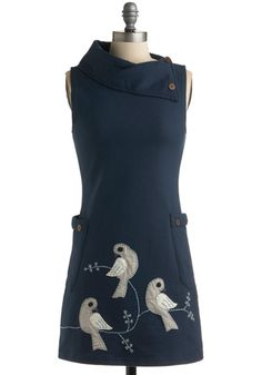 Love the pockets and the asymetrical collar. The birds would be cute on something for a little one.