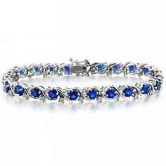 Bling Jewelry Bling Jewelry Cz Blue Sapphire Color Waved Silver Tennis... ($61) ❤ liked on Polyvore featuring jewelry, bracelets, blue, tennis bracelet, silver jewellery, blue bridal jewelry, bride jewelry and blue jewelry