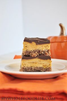 No Bake Pumpkin Creme Bars. 3 Amazing layers. A cinnamon pecan crust, creamy pumpkin layer and topped with chocolate. #vegan #glutenfree #paleo #pumpkin