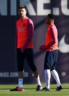 Gerard Pique (L) and Neymar Jr. of FC Barcelona talk during a training session ahead of their La Liga match between FC Barcelona and Real Madrid on December 2, 2016 in Barcelona, Catalonia.
