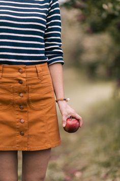 Madewell button front skirt, KJP jumper, and KJP pearl knot bracelet.