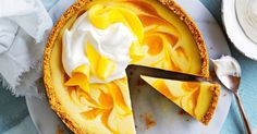 Serve this gorgeous mango and white chocolate cheesecake with whipped cream and thinly sliced fresh mango pieces.