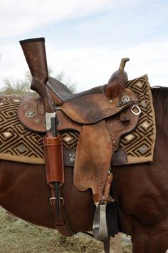 Designed to fit both lever action rifle, carbine or shotgun, this Long Gun Scabbard mounts directly to the rear rigging dee of western saddle, and is all one piece for easy installation or…More Gun Holster, Leather Holster, 1911 Holster, Saddle Leather, Western Horse Tack, Western Saddles, Cowgirl And Horse, Cowboy Gear, Horse Gear