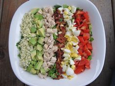 The classic Cobb salad can be a nutritional nightmare, but this version features a low-calorie French dressing that uses puréed vegetables to create a creamy base. Pimientos give it the familiar fl...
