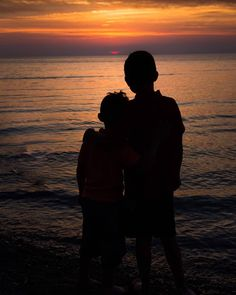 My boys enjoying the sunset on Father's Day. #weareparents #proudparent #prouddad #sunset #summer #water #lakeontario #silhouette #s2s2s2dio #justsaytheword #landscape #family