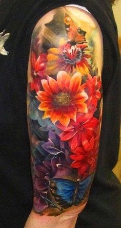 Flowered tattoo, amazing job. Something like this for all the women in my life. Favorite flower of each