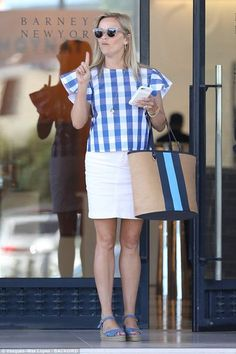 Reese Witherspoon, 41, embraced summer chic as she put on a leggy display in a white skirt which she paired with a Draper James gingham top for a shopping trip in Beverly Hills on Tuesday.