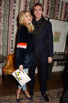 Poppy Delevingne (in Shrimps coat, Anya Hindmarch clutch bag) and James Cook - Screening of 'St Vincent' in London. (December 8, 2014)