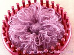 """8"""" flower made using a knitting loom (weird page of fuzzy and plastic raffia tenerife 'flowers' & 'snowflakes.'"""