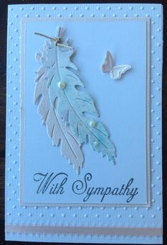 Sympathy female card featuring feathers and a butterfly. Handmade by Michele Hinton