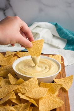 """Easy, vegan queso made with cashews and green chilis. This dairy-free """"cheesy"""" dip is so flavorful! Perfect for a snack or appetizer. Vegan Cheese Recipes, Vegan Sauces, Vegan Dishes, Free Recipes, Vegetarian Recipes, Vegan Queso Dip, Vegan Chips, Vegan Appetizers, Cucumber Appetizers"""