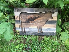 """DESCRIPTION This is a unique cow silhouette wood wall art. Its perfect for a farmhouse and brings a rustic touch to any room. This piece is made out of pine uniquely stained to look like rustic reclaimed wood. DETAILS Measures 18.5"""" x 12.5"""" Preinstalled with wire for hanging Two"""