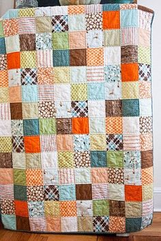 I'm not a fan of orange and brown, but still like this.  And the quilting method actually looks achievable.