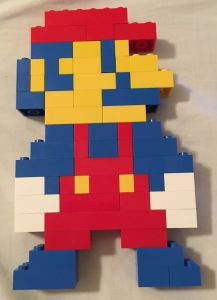 My son is counting pixels once again! This time he made a Lego Mario using only regular bricks from the Creator box set. Using blue, yellow, red, and white bricks his goal was to make 8 bit Mari… Mario Bros, Mario And Luigi, Lego Duplo, Bloc Lego, Lego Mario, Alex Craft, Modele Lego, Lego Valentines, Lego Mosaic