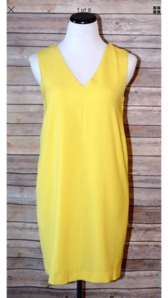 Pretty yellow hue,medium-weight woven poly dress, with asleeveless cut, V-neck and back, and shift silhouette. Gold clasp closure at back and pockets.    Fully lined.    Self: 95% Polyester, 5% Elastane. Lining: 97% Polyester, 3% Spandex. Hand Wash Cold.    Runs big, oversized fit    Brand : FRNCH Lucy Paris | Shop this product here: http://spreesy.com/shoptopshelfwardrobe/1875 | Shop all of our products at http://spreesy.com/shoptopshelfwardrobe    | Pinterest selling powered by…