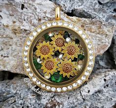 Origami Owl. Gold Twist with sunflower charms and crystals, so pretty!