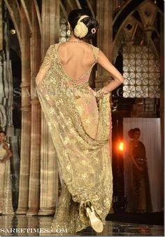 gold designer embroidery shimmer faux georgette #Saree with sequins butties & border work paired with designer backless saree blouse from designer TARUN TAHILIANI at Aamby Valley India Bridal Week 2011.