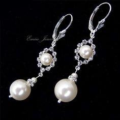 loving these earrings for the wedding! http://www.etsy.com/listing/68023673/ivory-swarovski-pearls-clear-rhinestone