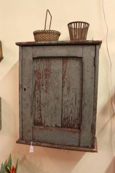 Love the old patina of the cupboard