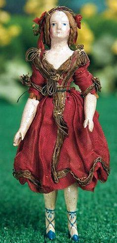 Rare Early Miniature Carved Wooden Doll with Original Wig and Fancily Painted Shoes.