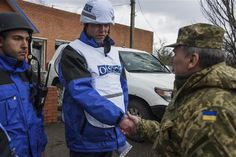 """One Ukrainian serviceman has been killed and eight wounded in fresh separatist attacks, the military said in Kyiv on May 21, as the OSCE security watchdog warned of a """"worrisome"""" spread of violence in eastern Ukraine."""