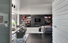 Braga House 1 / Casa do Passadiço @casadopassadico #living #hometheater #shelves #wall