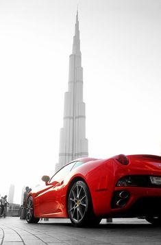 Ferrari California in front of the Burj Tower in Dubai.