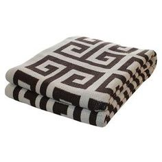 Add a pop of pattern to your sofa or bed with this eco-friendly throw. Made from recycled cotton.  Product: ThrowConstruction Material: 80% Recycled cotton and 20% acrylicColor: Coffee Features: Made in the USAEco-friendly Dimensions: 50 x 60Cleaning and Care: Machine wash and dry on low