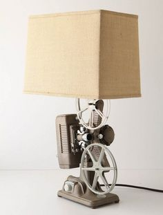 Old-school projector turned side lamp! - Turn old things into lamps. Now that's why you live with a light engineer. Good idea.