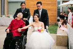 "The story behind this picture is incredible and will bring tears to your eyes.  The bride underwent surgery for a torn Achilles' tendon just before her wedding.  Her father was deteriorating quickly from Parkinson's and the family was not sure if he would be able to attend the wedding.  On the day of, her father was able to ""walk"" her down the aisle (they were in matching wheelchairs!) and gave her away.  Her father passed away the next day.  This is truly a picture to cherish."