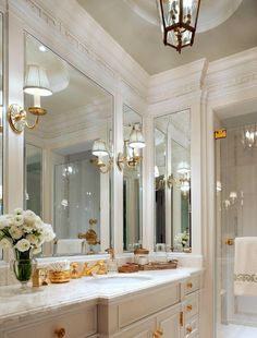 Marble and gold. love mirror placement for enlarging and sconces mounted off mirrors but close