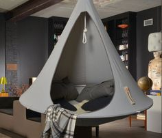 Set an atmosphere of outdoor #camping indoors. By simply looking at the Grey Double Hanging #Cacoon, you can say it's kind of a luxury refuge for hanging indoors.